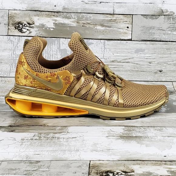 a0a4c3320b9f Nike Shox Gravity Women s Shoe Metallic Gold